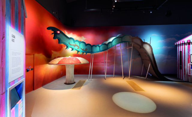 Alice Curiouser and Curiouser at V&A Museum, London. Installation image featuring the caterpillar from Alice In Wonderland.