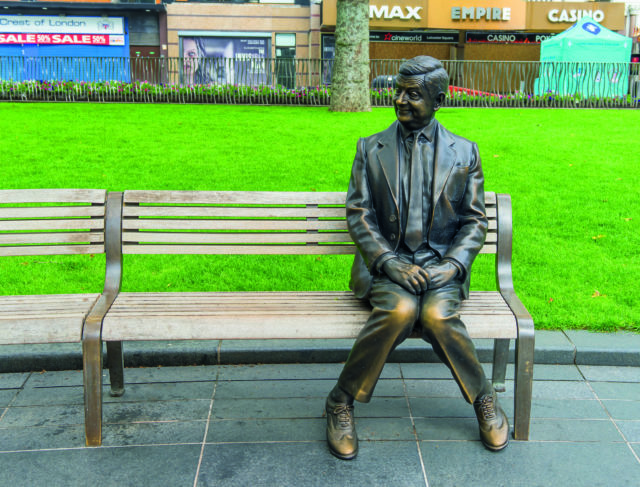 Rowan Atkinson Bronze Statue of Mr Bean,Sitting On A Bench, Leicester Square, London