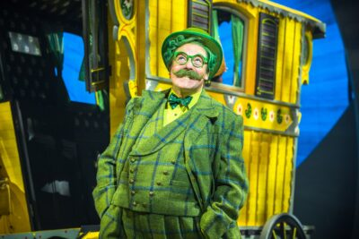https://londonplanner.com/wp-content/uploads/2021/07/Rufus-Hound-as-Mr-Toad-in-The-Wind-in-the-Willows.-Photo-by-Marc-Brenner.-Copyright-Jamie-Hendry-Productions.jpeg