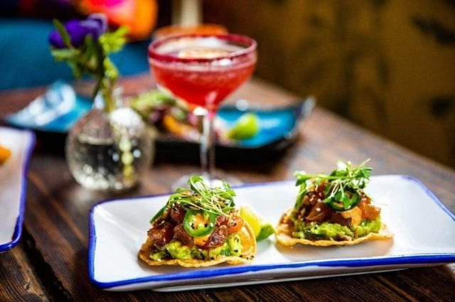 Santo Remedio, London. Mexican restaurant table featuring bottomless brunch tacos and a cocktail.