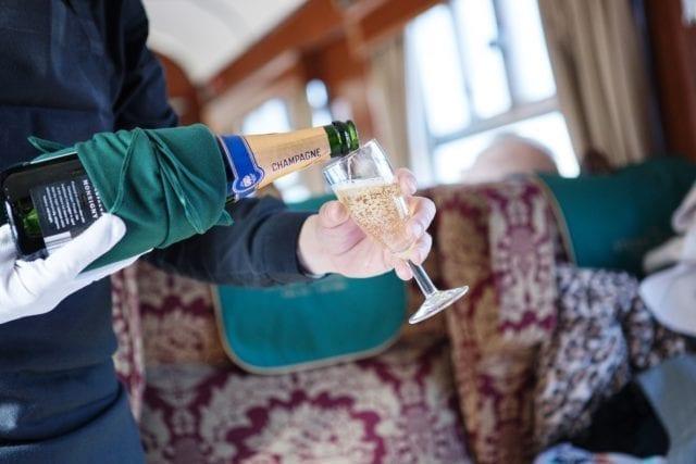 Champagne aboard Steam Dreams Rail Co