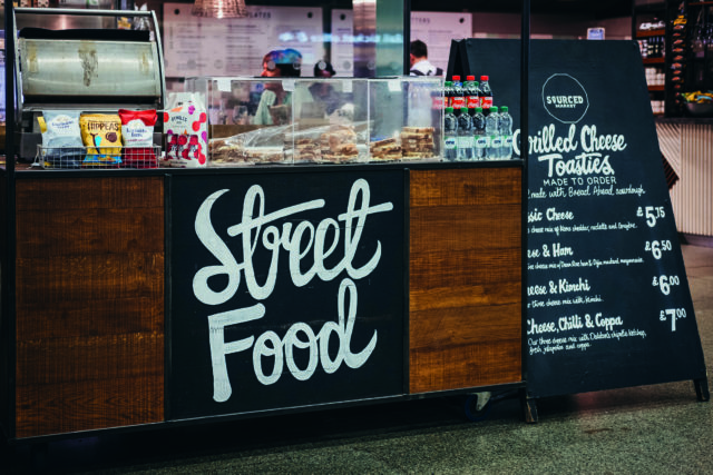 Street food stall inside St. Pancras station, one of the largest railway stations in London and home to Eurostar.