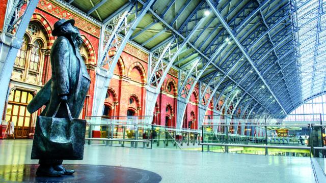 Statue of passenger inside London's St Pancras International train station