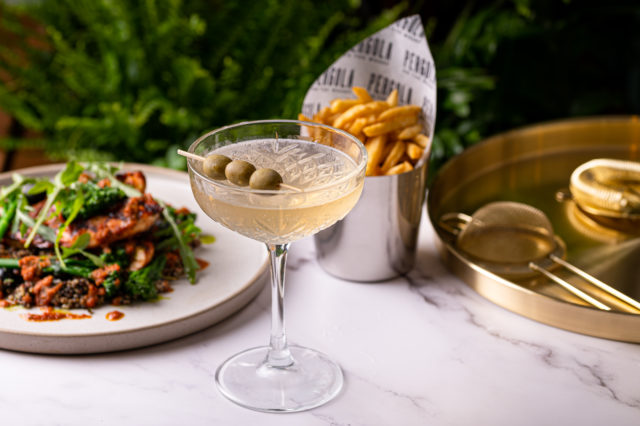 Martini with olives, chips and other delicious food at Pergola on the Wharf in London's Canary Wharf